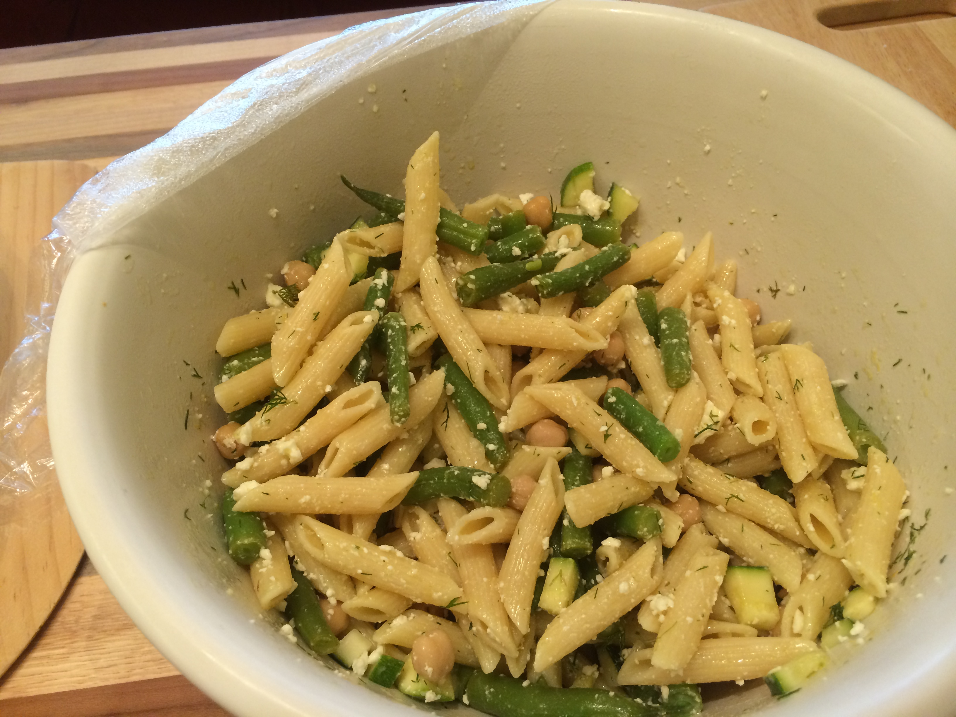 Zucchini pasta salad with green beans, feta, garbanzo beans and dill